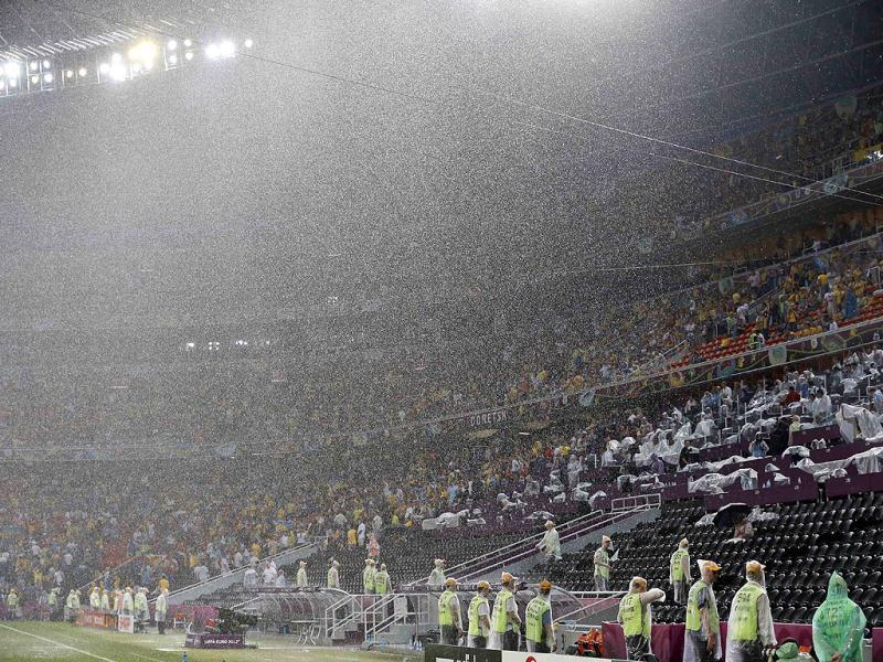 Heavy rain falls as the match is suspended during the Euro 2012 soccer championship Group D match between Ukraine and France in Donetsk. AP Photo/Matthias Schrader