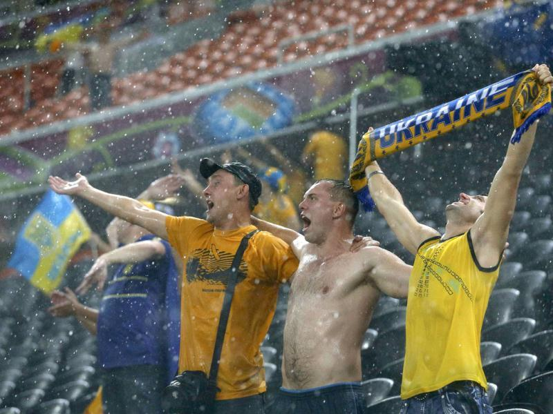 Fans of Ukraine react during a heavy rain as their Group D Euro 2012 soccer match against France was suspended at Donbass Arena in Donetsk. Reuters/Alessandro Bianchi