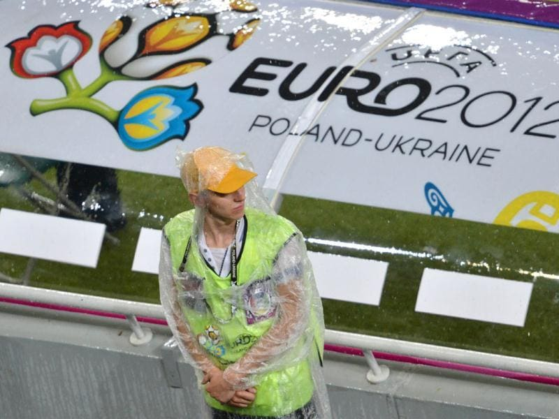 A steward is pictured at the Donbass Arena in Donetsk as the Euro 2012 championships football match Ukraine vs France has been suspended because of bad weather conditions. AFP Photo/Sergei Supinsky