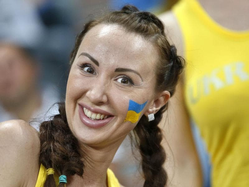 A Ukraine supporter smiles prior to the Euro 2012 soccer championship Group D match between Ukraine and France in Donetsk, Ukraine. AP Photo/Matthias Schrader