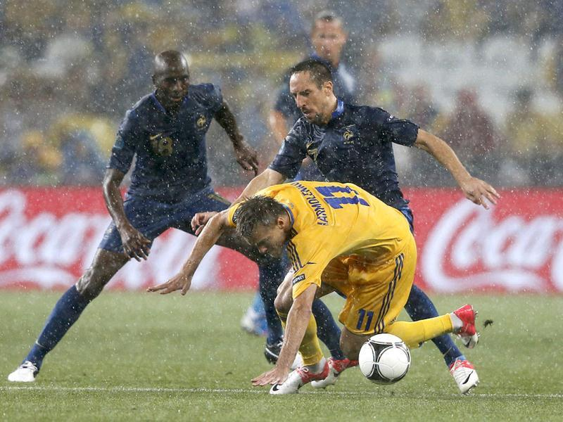 Ukraine's Andriy Yarmolenko (front) falls down as he is challenged by France's Franck Ribery (R) during their Group D Euro 2012 soccer match in Donetsk. Reuters/Yves Herman