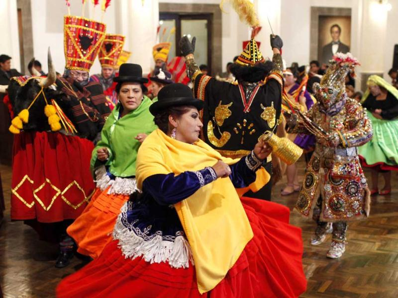 Dancers perform the traditional Waca Tokh'oris during a ceremony at the government palace in La Paz, Bolivia. AP/Juan Karita