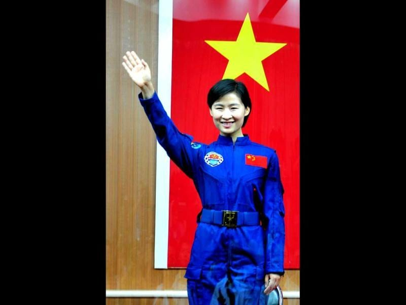 China's first female astronaut Liu Yang salutes during a ceremony at the Jiuquan space base, north China's Gansu province. AFP Photo