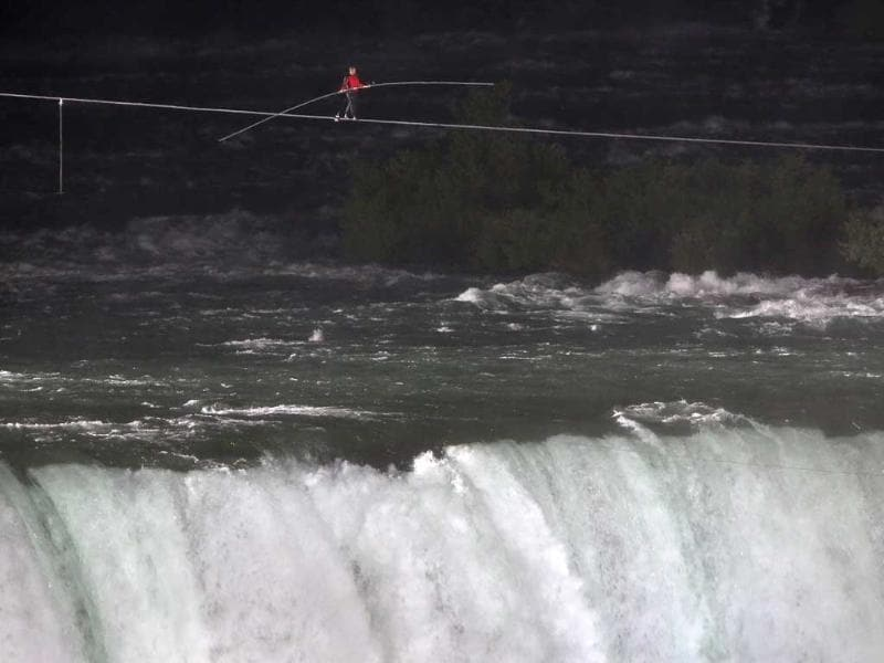 Aerialist Nik Wallenda tighropes over the Niagara Falls in New York. ABC televised the event and insisted the daredevil wear a teathered harness to prevent live coverage of a potentially deadly fall 190 feet into the churning torrent below. AFP/John Moore