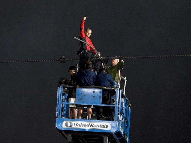 Nik Wallenda pumps his fist as he completes his 1,800 feet-long tightrope walk over the brink of the Niagara Falls in Ontario. AP/The Canadian Press, Aaron Vincent Elkaim