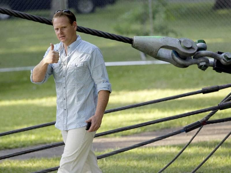 Nik Wallenda greets fans after inspecting the wire prior to his walk across Niagara Falls in NY. AP/David Duprey
