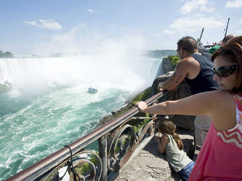 A family looks as the Maid of the Mist turns around at Niagara Falls, where Nik Wallenda walked a 550 metre-long tightrope in Niagara Falls, Ontario. AP/The Canadian Press, Aaron Vincent Elkaim