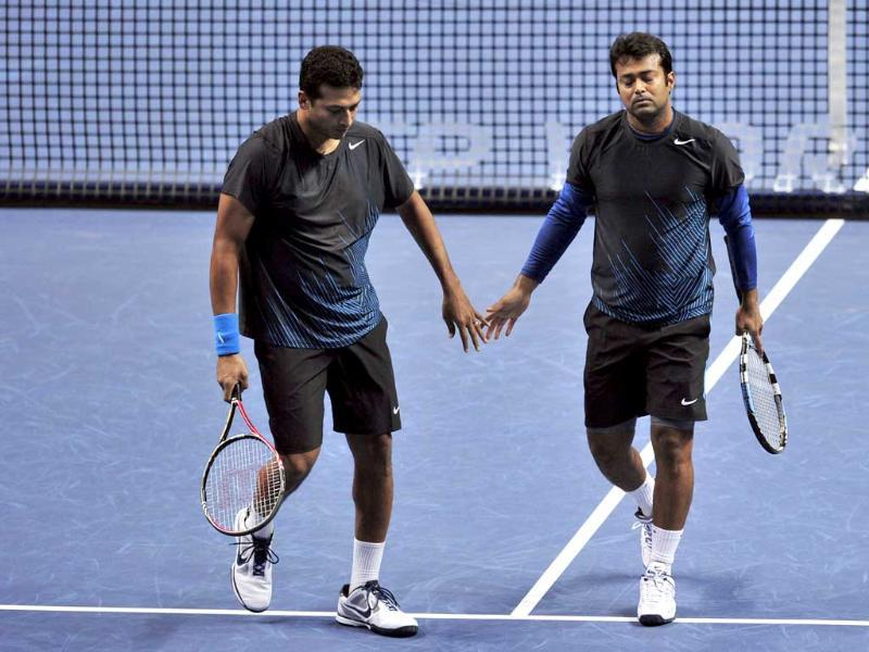 (File) Leander Paes (R) and Mahesh Bhupathi touch hands during the ATP World Tour Finals tennis tournament in London. Bhupathi has refused to play with Leander at the Olympics, saying he does not trust his erstwhile partner. AFP/Glyn Kirk