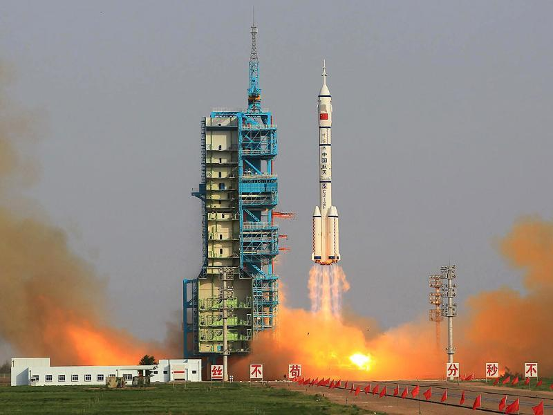 In this photo released by China's Xinhua News Agency, the Long March-2F carrier rocket carrying China's manned Shenzhou-9 spacecraft blasts off from the launch pad at the Jiuquan Satellite Launch Center in Jiuquan, northwest China's Gansu Province. (AP Photo/Xinhua, Li Gang)