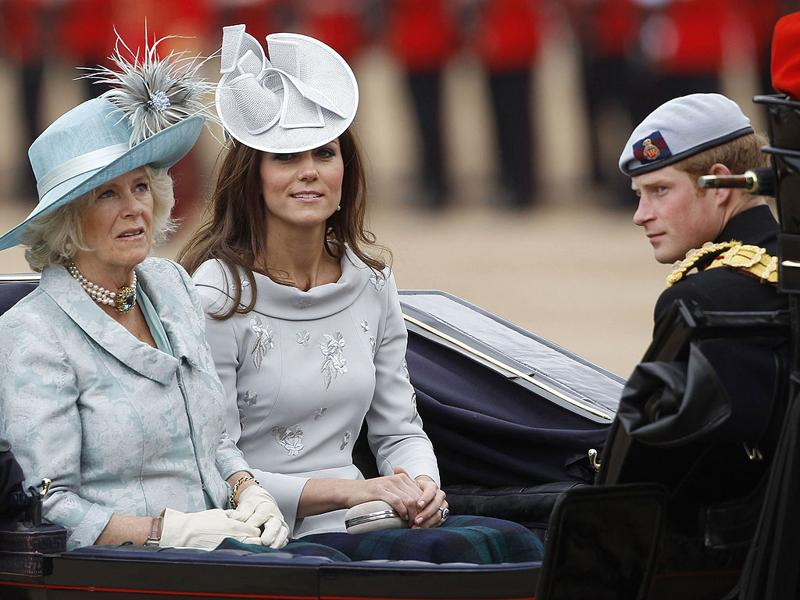 Britain's Camilla, Duchess of Cornwall (L), Catherine, Duchess of Cambridge (C) and Prince Harry travel to Horse Guards Parade for the Trooping the Colour ceremony in central London. REUTERS/Suzanne Plunkett