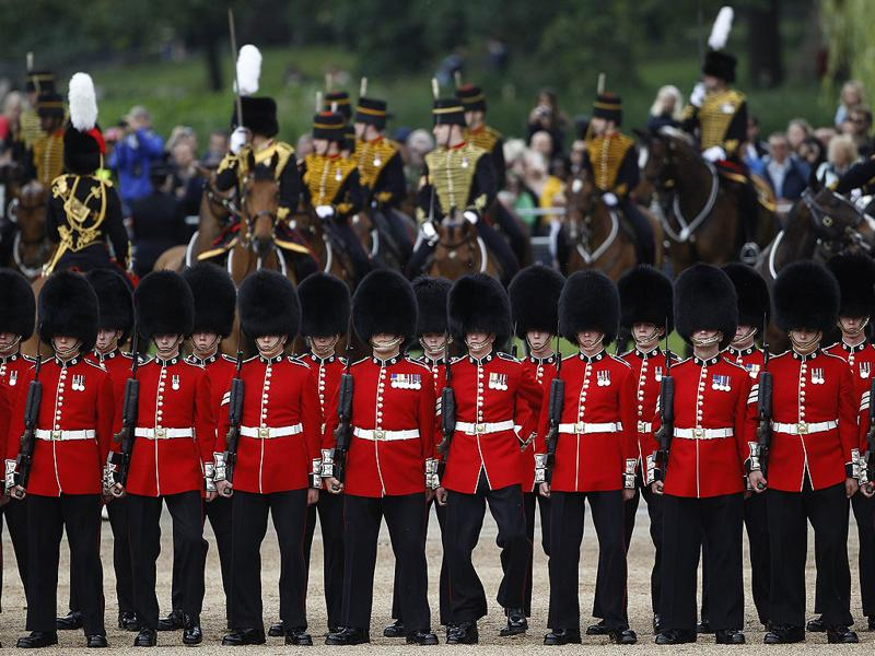 Guardsmen assemble for the Trooping the Colour ceremony on Horse Guards Parade in central London. REUTERS/Suzanne Plunkett