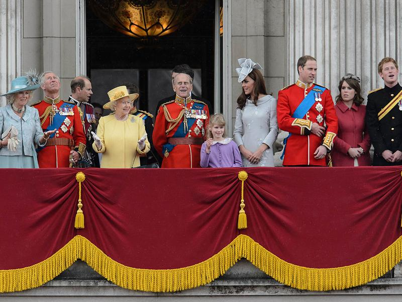 Queen Elizabeth II gestures as she stands with other members of the Royal Family on Buckingham Palace balcony following the Queen's Birthday Parade, 'Trooping the Colour' at Horse Guards Parade in London. The ceremony of Trooping the Colour is believed to have first been performed during the reign of King Charles II. In 1748, it was decided that the parade would be used to mark the official birthday of the Sovereign. AFP/Leon Neal