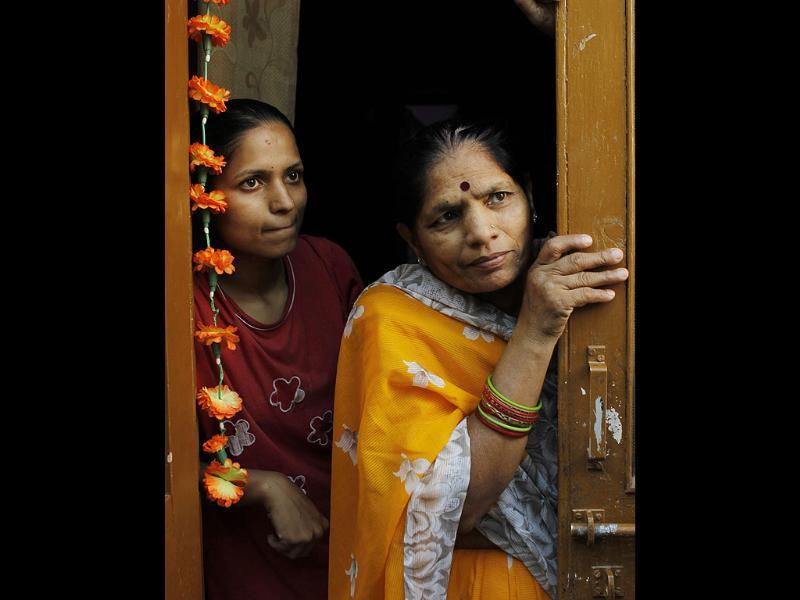 The neighbours of the two sisters who had confined themselves in their house for over six years and were rescued in critical condition by their relatives and admitted in Baba Saheb Ambedkar hospital in Rohini sector 8, in New Delhi. (HT Photo/Sunil Saxena)