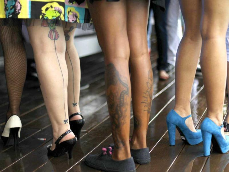 The tattooed legs of women are seen during the first National Tattoo contest in Panama City. Reuters/Carlos Jasso