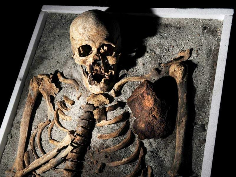A skeleton with an iron piece before being exposed at the National History museum in Sofia. The ancient skeleton of a man, pinned down in his grave in order not to turn into a vampire, piqued interest in Bulgaria this week, where vampire tales and rites still keep their bite even nowadays. The 700-year-old skeleton unearthed in the necropol of a church in the Black Sea town of Sozopol earlier in June -- was stabbed in the chest with an iron rod and had his teeth pulled before being put to rest. AFP/Nikolay Doychinov