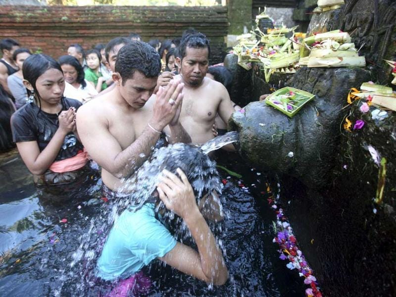 People take a bath in holy water during Banyu Pinaruh, a Hindu festival in Bali, Indonesia. AP/Firdia Lisnawati