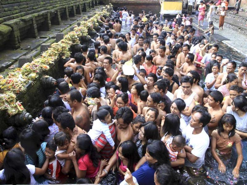Indonesians during Banyu Pinaruh, a Hindu procession to purify themselves and pray for wisdom and wit in Tampaksiring. AP/Firdia Lisnawati