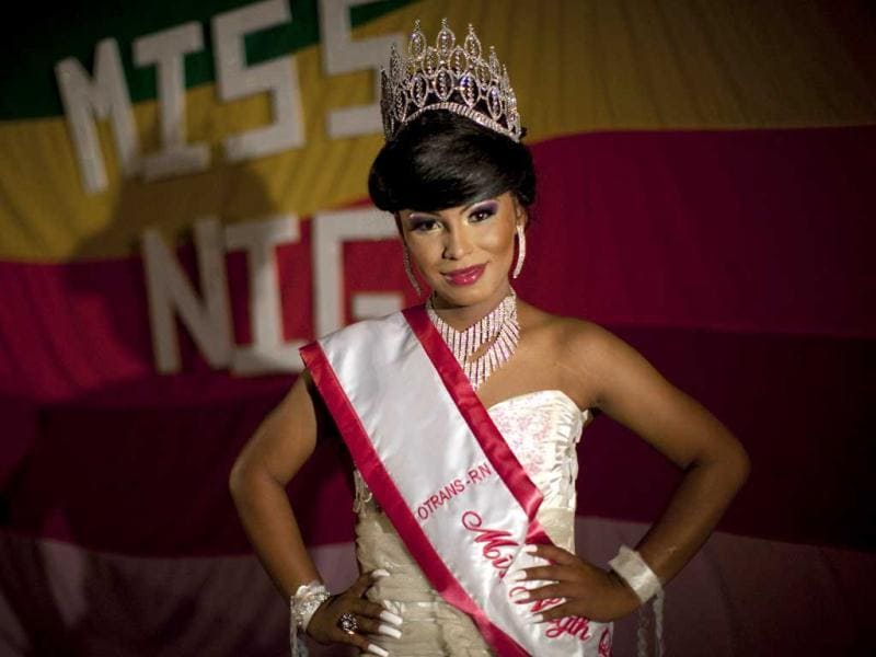 Transgender Kendra Ferrari, 21, poses for a portrait after winning the Miss Night Queen beauty pageant in Guatemala City. Ferrari will represent the transgender community for one year. (AP Photo/Rodrigo Abd)