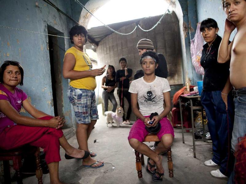 Transgenders and friends watch the door as someone enters where they are preparing for the Miss Night Queen beauty pageant in Guatemala City.(AP Photo/Rodrigo Abd)