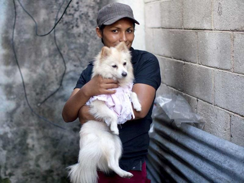 Kendra Ferrari, 21, a transgender, poses for a picture with a dog as contestants prepare for the Miss Night Queen beauty pageant in Guatemala City. (AP Photo/Rodrigo Abd)