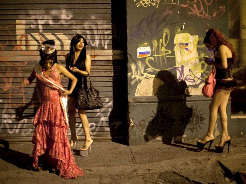 Transgenders leave the disco after the Miss Night Queen beauty pageant in Guatemala City. The winner will represent the transgender community for one year. (AP Photo/Rodrigo Abd)