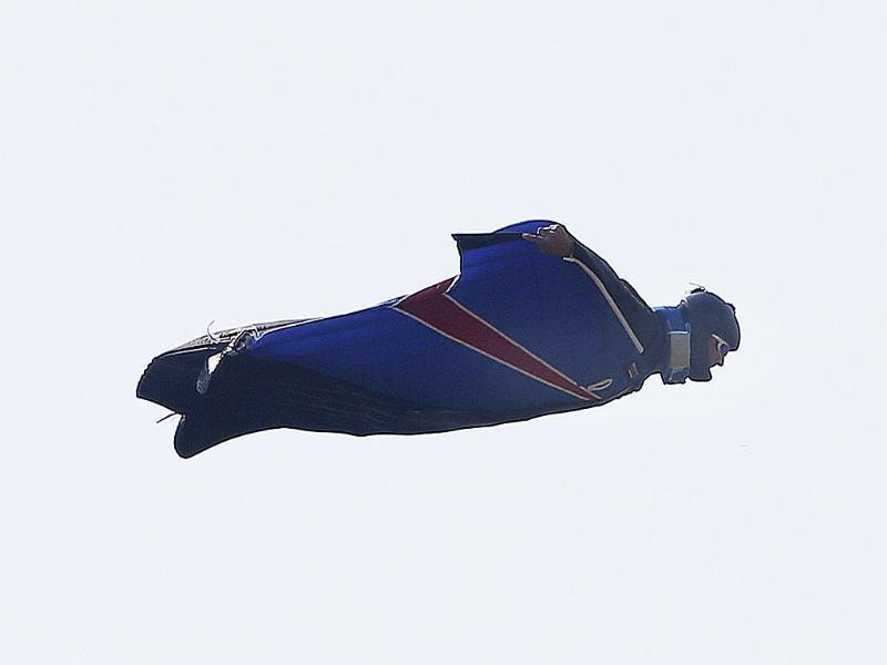 Stuntman Gary Connery is seen in the sky wearing a specially developed wingsuit near Henley-on-Thames, west of London. He had jumped from a helicopter at 2,400 feet and successfully landed without the use of a parachute. REUTERS/Eddie Keogh