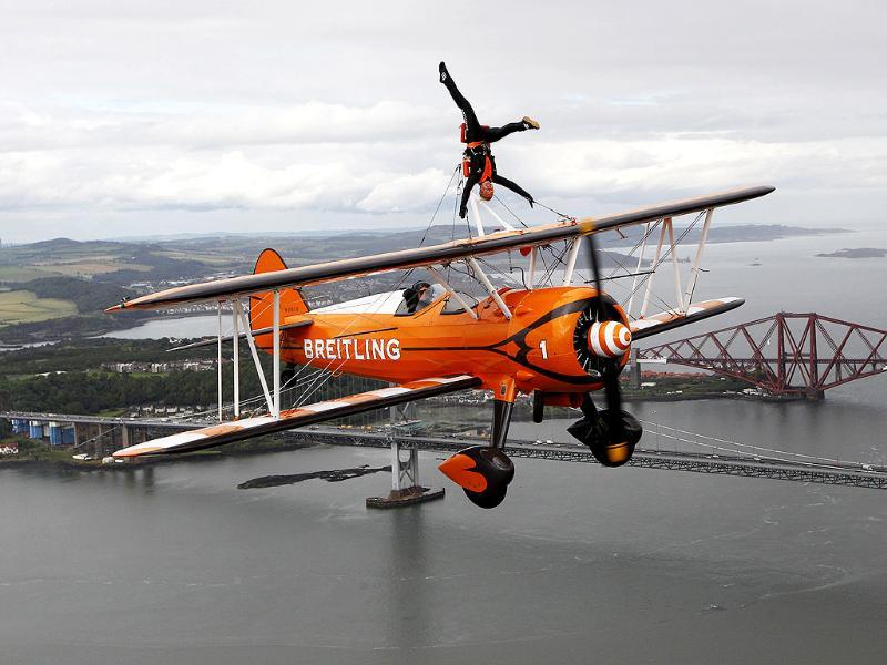 Team Breitling wingwalker Charlotte Voce performs, in advance of their appearance at an airshow at the National Museum of Flight at East Fortune, over the Firth of Forth in Scotland. REUTERS/David Moir