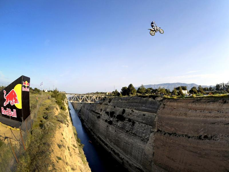 Australian stunt Motocrosser Robbie Maddison, 28, jumps over the 85-metre (279-feet) wide Corinth Canal at height of nearly 100 metres (328-feet) in Greece. REUTERS/Joerg Mitter