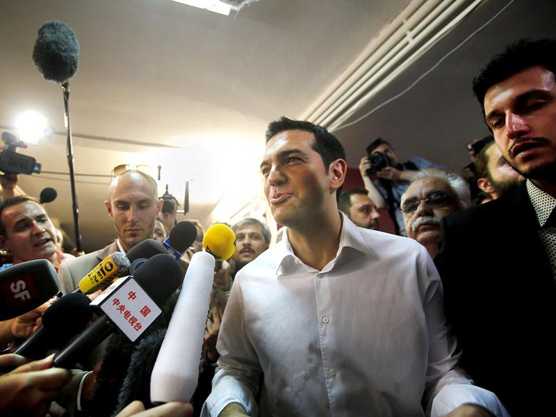 Head of Greece's radical leftist SYRIZA party Alexis Tsipras talks to the media at a polling station in Athen. REUTERS/Yannis Behrakis