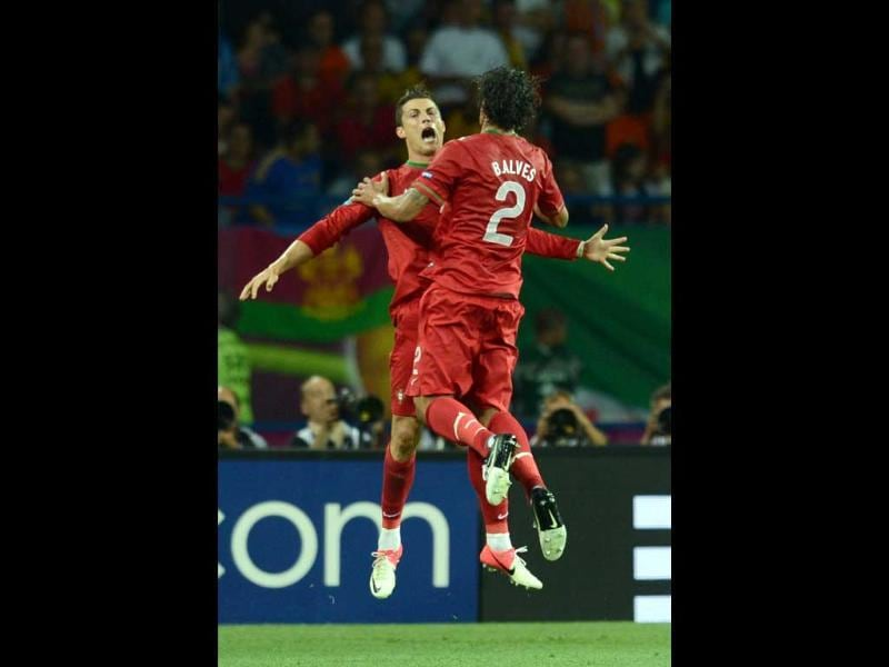 Portuguese forward Cristiano Ronaldo celebrates with Portuguese defender Bruno Alves after scoring his second goal during the Euro 2012 football championships match Portugal vs. Netherlands at the Metalist stadium in Kharkiv. AFP/Francisco Leong