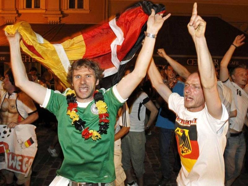 German soccer fans celebrate in central Lviv after their team won the Group B Euro 2012 soccer match against Denmark. Reuters/Gleb Garanich