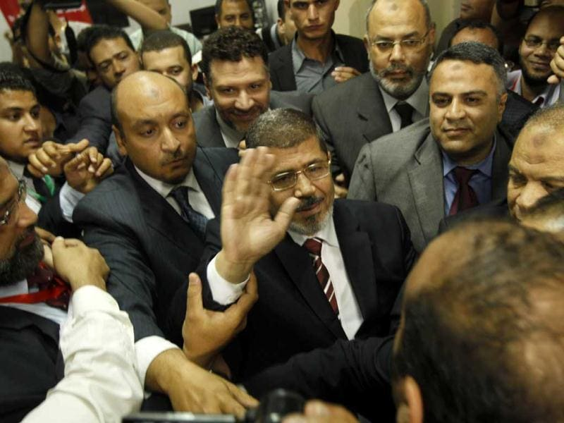 Egypt's Muslim Brotherhood candidate Mohammed Mursi waves amongst his supporters after the announcement of presidential election results at the electoral headquarters in Cairo. AFP/Mohammed AbedMohammed Mursi
