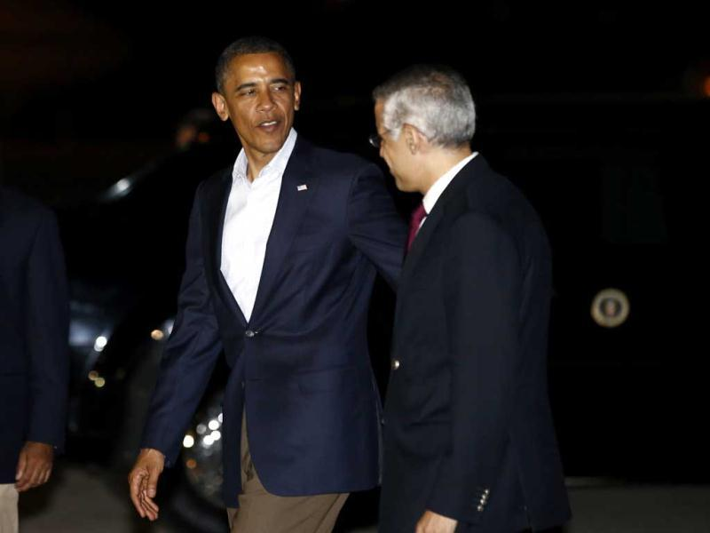 US President Barack Obama (L) is greeted by Mexico's Undersecretary for North America Julian Ventura upon Obama's arrival in Los Cabos. Reuters/Jason Reed