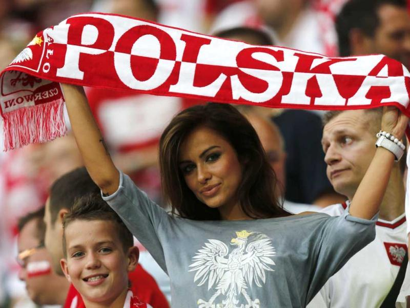 A fan of Poland holds up a team scarf before the start of their Group A Euro 2012 soccer match against Czech Republic at the City Stadium in Wroclaw. (Reuters/Dominic Ebenbichler)