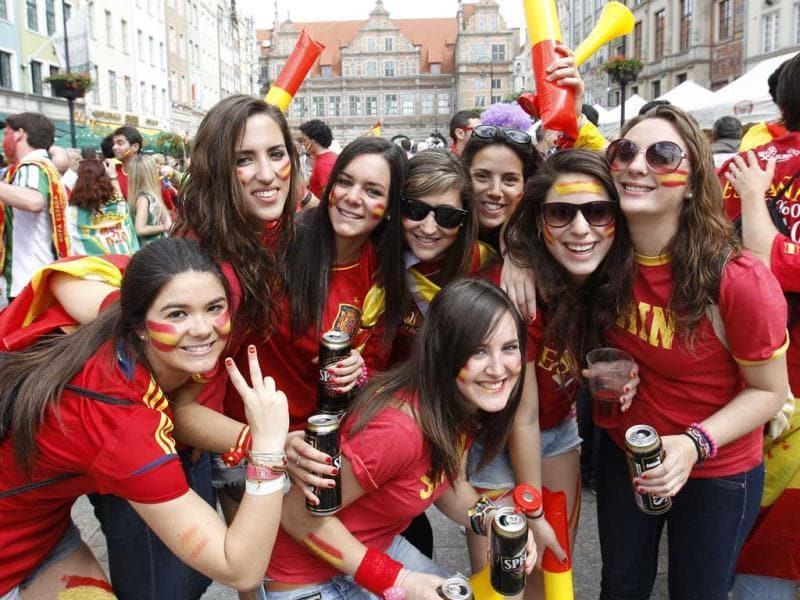 Spanish fans enjoy themselves prior to their first match of the Euro 2012 against Italy in the Long Market in Gdansk. (Reuters/Peter Andrews)