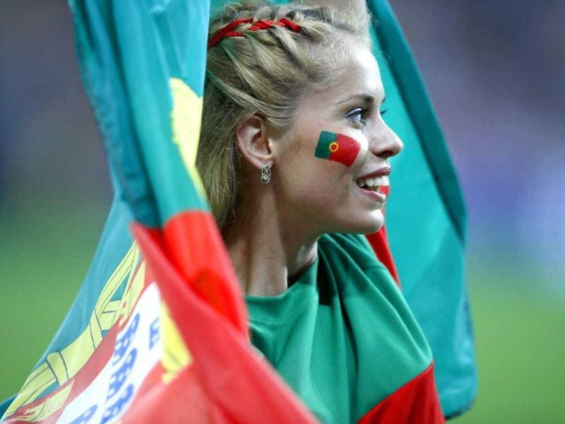 A Portugal team supporter with the painted face and national flag cheers before the start of their Group B Euro 2012 soccer match against Germany in Lviv. (Reuters/Michael Dalder)