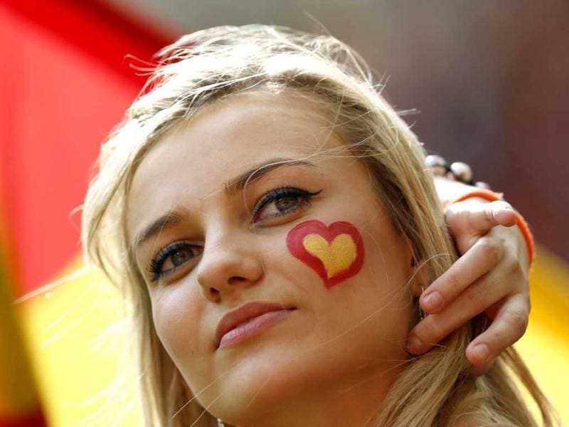 A Spanish supporter with a heart in the Spanish colours painted on her cheek waits for the start of the Group C Euro 2012 soccer match between Spain and Italy at the PGE Arena in Gdansk. (Reuters/Pascal Lauener)
