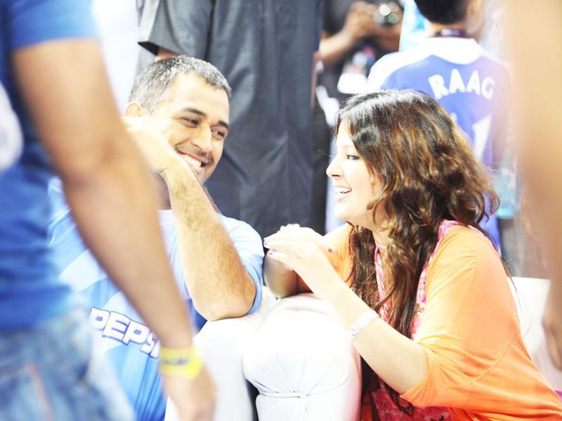 M S Dhoni talks to his wife Sakshi during the event.