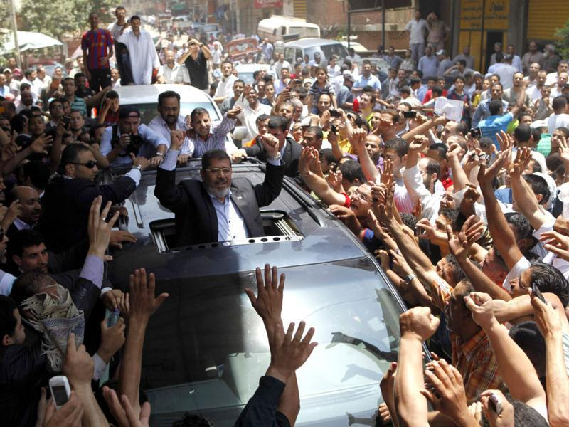 Presidential candidate Mohamed Morsy of the Muslim Brotherhood waves to a crowd in Cairo. Egypt's Muslim Brotherhood declared that its candidate Morsy won the country's first free presidential race. Reuters/Steve Crisp/Files