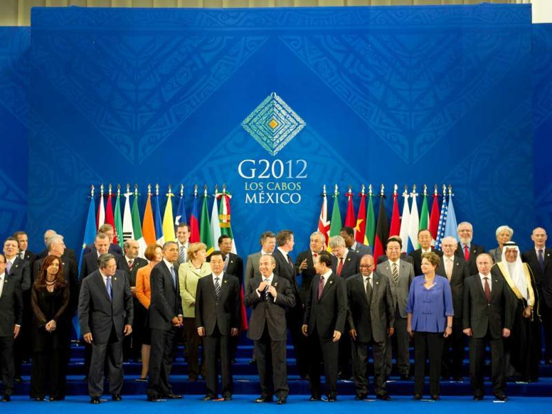 Heads of the G20 leading economies pose for a family photo at the convention center in Los Cabos, Mexico. AFP Photo/Bertrand Langlois