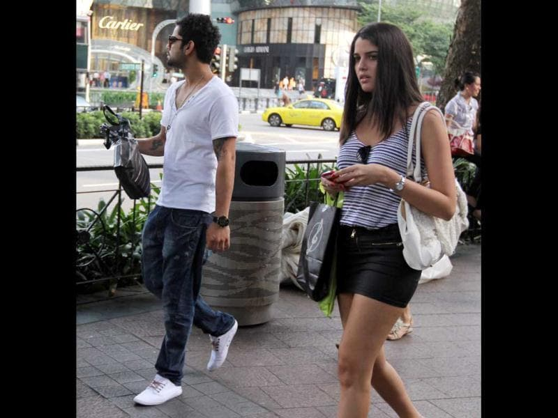 Hot Indian cricketer Virat Kohli was snapped with a mystery woman in Singapore.