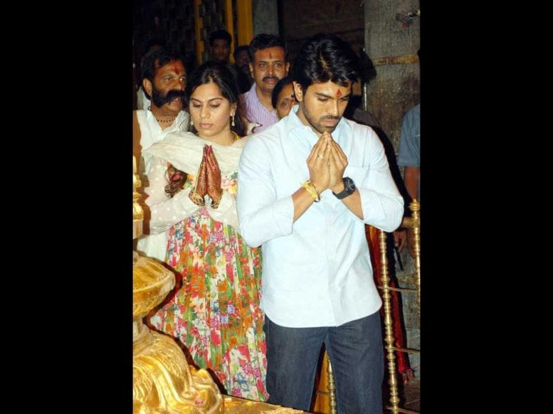 Newly-married couple Ram Charan Teja and wife Kamineni Upasana were recently spotted praying together at a temple in Tirumala.