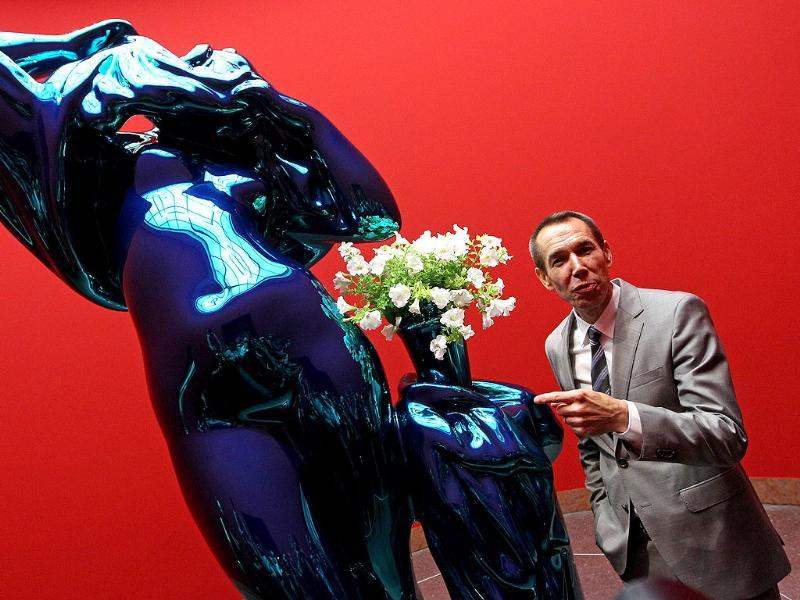 US artist Jeff Koons poses for a photo in front of the sculpture 'Metallic Venus' during the opening of the exhibition Jeff Koons - The Painter & The Sculptor taking place both at the Liebighaus Skulpturen Sammlung and the Schirn Kunsthalle in the central German city of Frankfurt. AFP/Daniel Roland