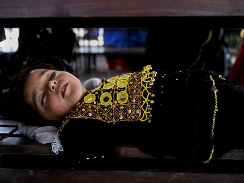 An Afghan girl sleeps at The United Nations High Commissioner for Refugees (UNHCR) registration centre on the outskirts of Peshawar, as she and others prepare to return to their home country after fleeing civil war and Taliban rule. AFP/A. Majeed