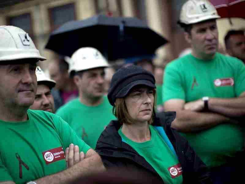 Coal miners attend a speech of one of their leader after taking part in a protest march in Langreo near Oviedo, Spain. (AP Photo/Emilio Morenatti)