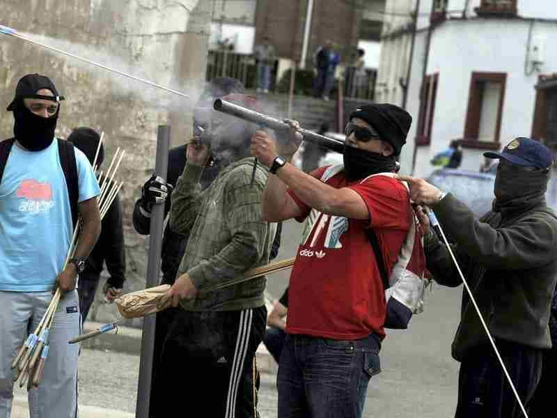 Coal miners fire rockets at the Guardia Civil officers during clashes in Cinera village near Leon, northern Spain. (Reuters/Eloy Alonso)