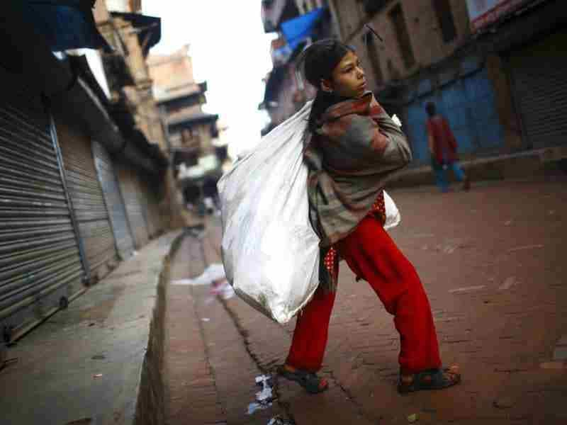 A girl carrying a plastic bag walks on a street in search of recyclable goods at the ancient city of Bhaktapur near Kathmandu. Reuters photo/Navesh Chitrakar