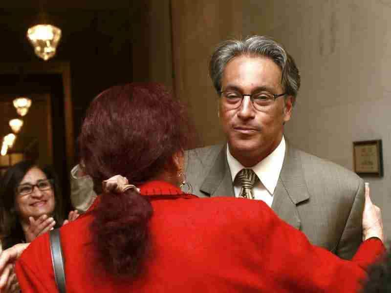 Suspended San Francisco Sheriff Ross Mirkarimi (R) greets a supporter before appearing at a San Francisco Ethics Commission hearing at City Hall in San Francisco. Reuters photo/Stephen Lam