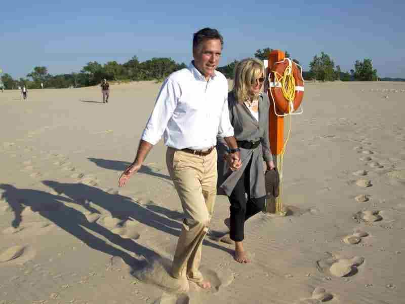Republican presidential candidate, former Massachusetts Gov. Mitt Romney, left, takes a walk with his wife Ann, on the beach after a campaign stop at Holland State Park in Holland, Mich. AP Photo/Evan Vucci
