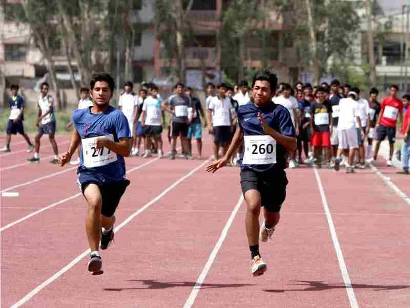 Aspirant students running a 50m dash during the Fitness trail test for admission at Shri Ram College of Commerce in New Delhi. HT/M Zhazo